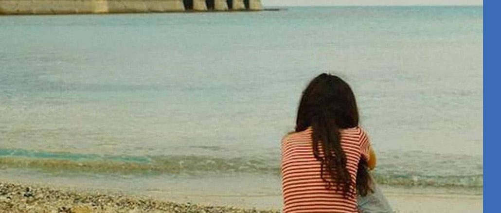 Picciridda con i piedi nella sabbia